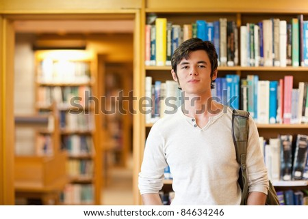 Smiling student standing up in a library