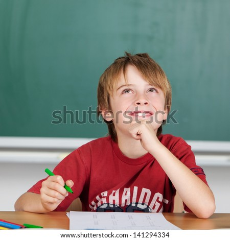 Smiling student while thinking to solve a problem - stock photo