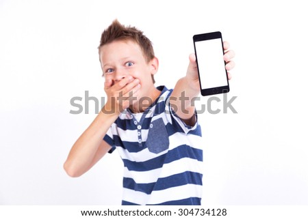 smiling student with a tablet in his hand screen to the client on a white background shows the application photo with depth of field. picture with artistic blur - stock photo