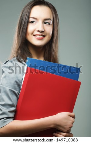 smiling student woman with folders