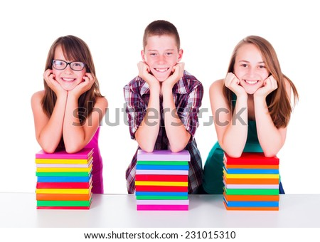 Smiling students with stacked colorful books - stock photo