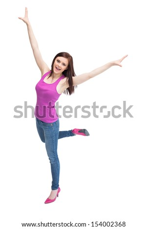 Smiling stylish brunette wearing high shoes cheering up on white background - stock photo