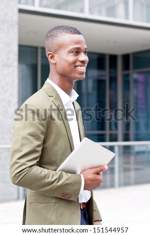 smiling successful businessman with tablet pc outdoor in summer