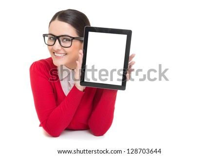 Smiling successful businesswoman showing digital tablet screen - stock photo