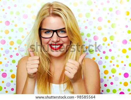 smiling successful woman with thumbs up - stock photo