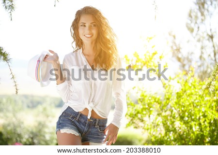 Smiling summer woman with hat  - stock photo
