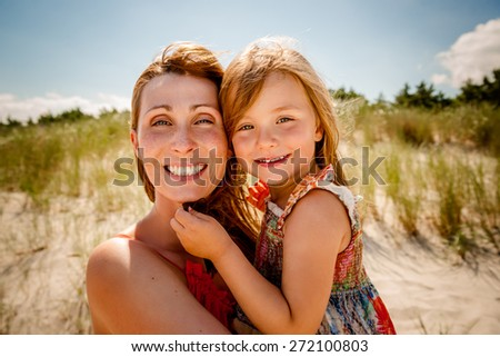 smiling summertime family on the beach