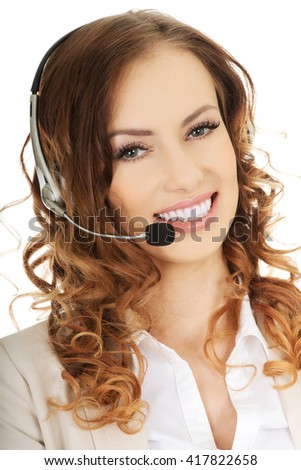 Smiling support phone operator in headset. - stock photo
