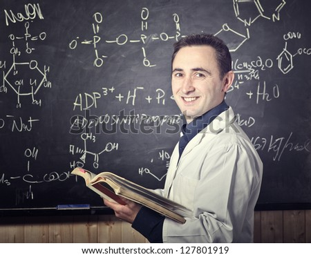 smiling teacher and blackboard background