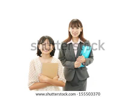 Smiling teacher with girl - stock photo