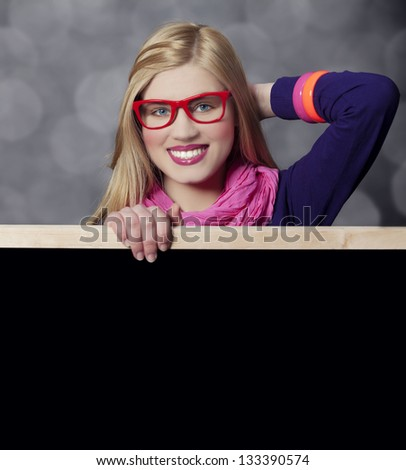 Smiling teen girl with blackboard. - stock photo