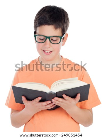 Smiling teenage boy of thirteen reading a book isolated on white - stock photo