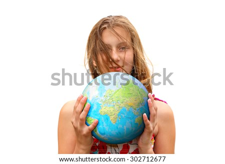 Smiling teenage girl holding a globe ball. Isolated on a white background
