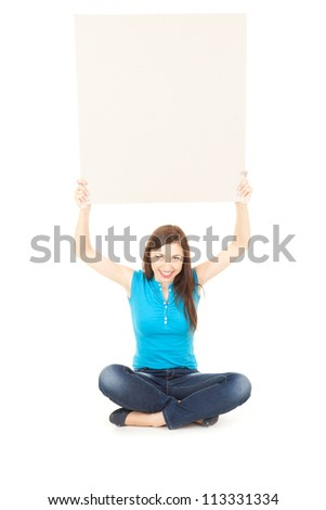 smiling teenage girl holding up empty board above his head, full length, white background - stock photo
