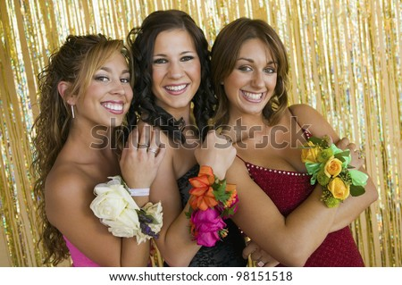 Smiling Teenage Girls Showing Prom Corsages - stock photo