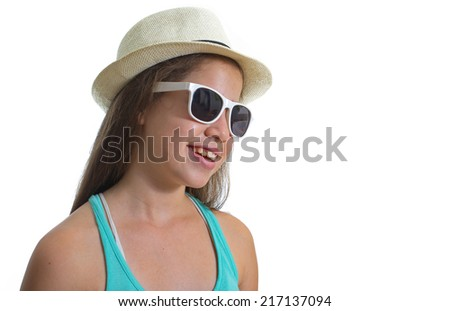 Smiling teenager girl wearing white rimmed sunglasses and a beige hat - stock photo