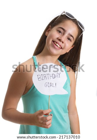 Smiling teenager girl with sunglasses holding an I'm a Birthday Girl sign - stock photo