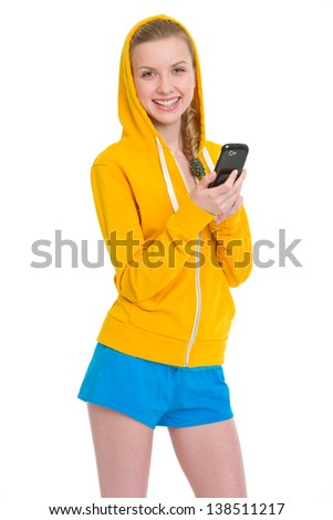 Smiling teenager girl writing sms