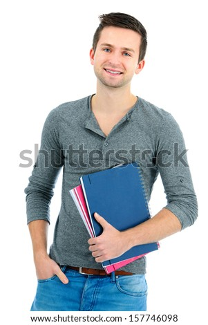 Smiling teenager with books standing isolated on white background - stock photo