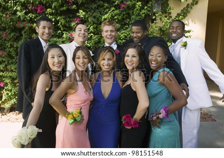 Smiling Teenagers Dressed for School Dance - stock photo
