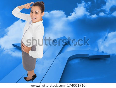 Smiling thoughtful businesswoman against arrows in the sky in blue