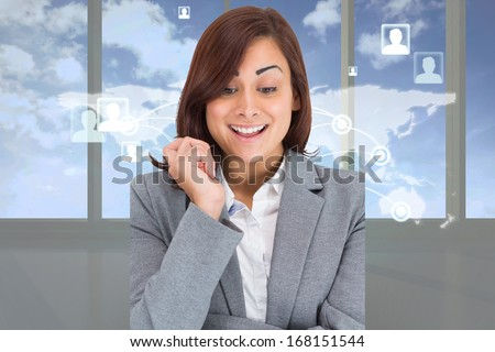 Smiling thoughtful businesswoman against blue arrow graphic