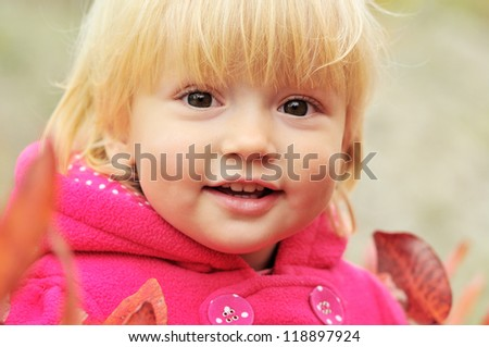 smiling toddler girl in fall time - stock photo