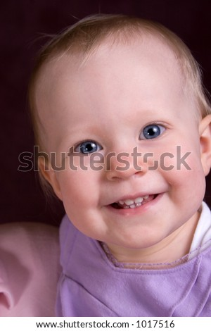 smiling toddler in purple