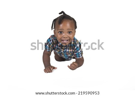 Smiling toddler isolated on a white background