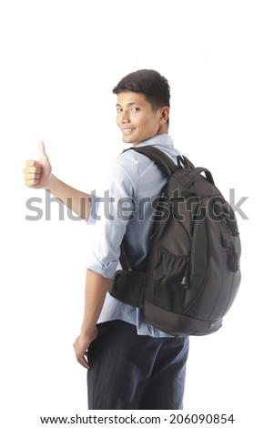 Smiling tourist with thumb up - stock photo