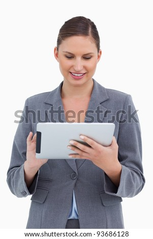 Smiling tradeswoman using her tablet computer against a white background - stock photo