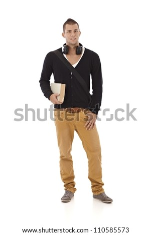 Smiling trendy university student guy with book and headphone, cutout on white, full size.