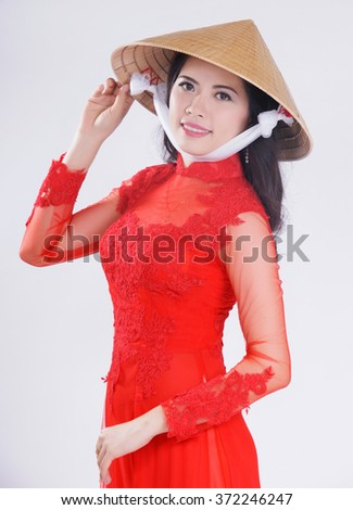 Smiling Vietnamese female with ao dai, vietnam traditional dress