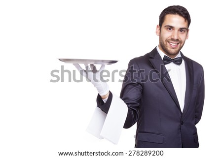 Smiling waiter holding an empty silver tray, isolated on white background - stock photo