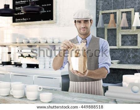 Smiling waiter holding and handing over takeaway sandwich wrapped in a paper bag.