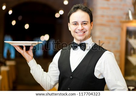 Smiling waiter in an elegant restaurant