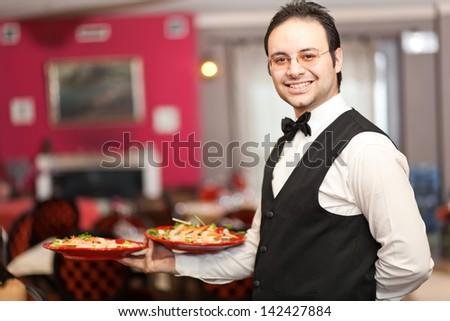 Smiling waiter portrait - stock photo