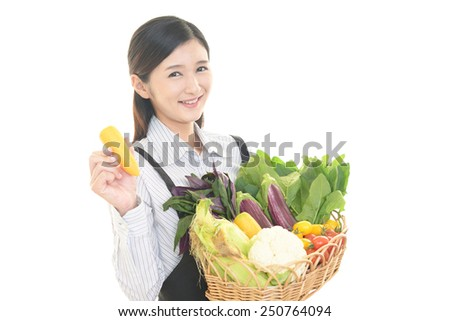 Smiling waitress holding vegetables