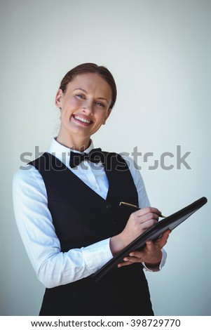 Smiling waitress taking an order in a restaurant