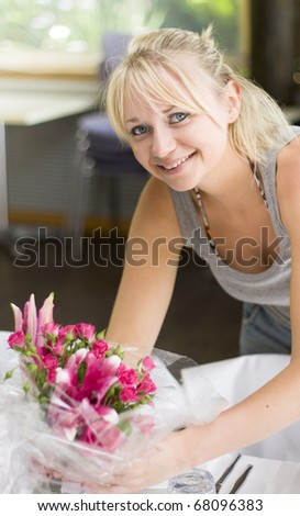 Smiling Wedding Planner Setting Up The Wedding Reception Venue By Organizing The Table Flowers Decorations Before The Formal Function Begins