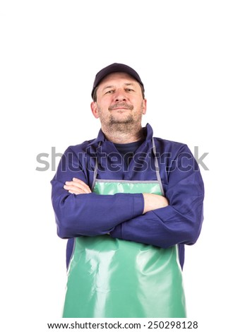 Smiling welder in apron with crossed hands. Isolated on a white background. - stock photo