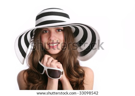 smiling white woman in striped hat with copy-space - stock photo