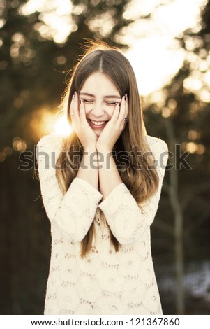 Smiling Winter Girl in the park - stock photo