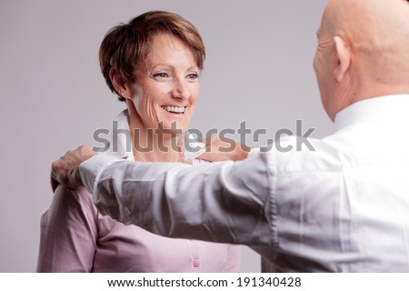 smiling woman approval by her boss: it's a success - stock photo