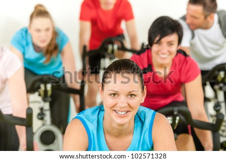 Smiling woman at class fitness workout people exercise - stock photo