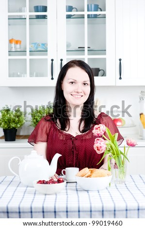 Smiling woman at home - stock photo