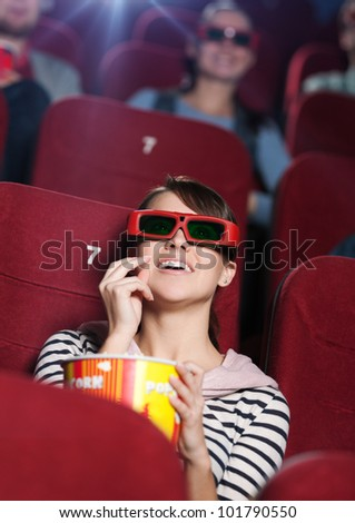 Smiling woman at the 3D cinema - stock photo