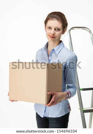 Smiling woman carrying big box, white background - stock photo
