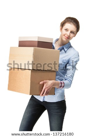 Smiling woman carrying big boxes, isolated on white - stock photo