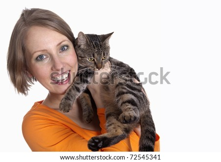 smiling woman cuddling her cute little young kitten isolated on white background
